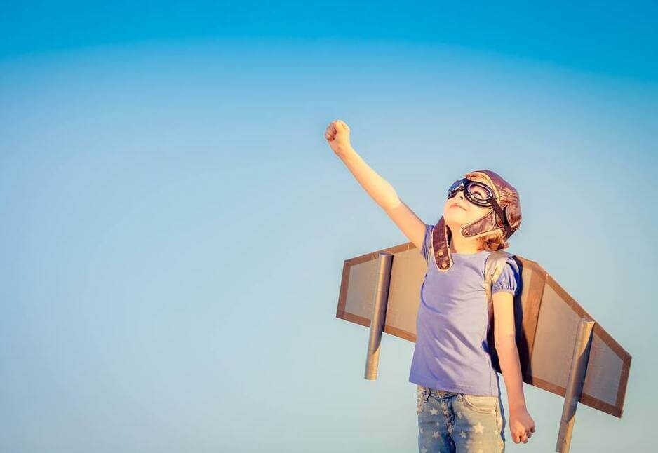 dedicated and motivated to fly with her cardboard jetpack on