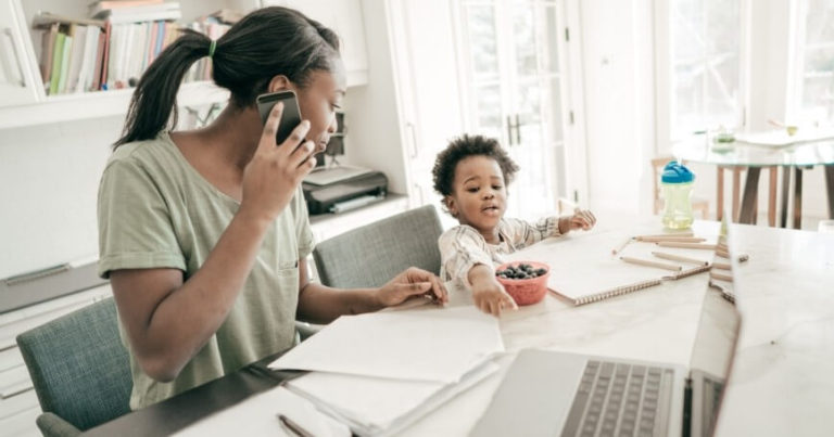 mom with child while working from home